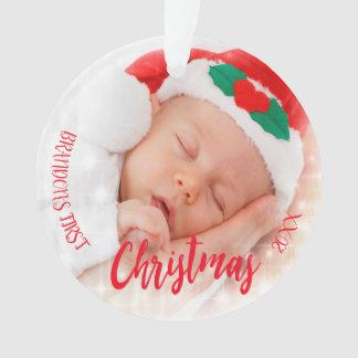 Premier rouge d'ornement de photo de Noël du bébé