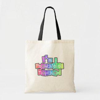 Professeur intelligent d'école maternelle de coule sacs de toile