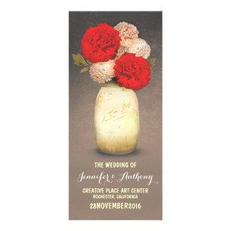 programmes rouges peints d'or de fleurs de pot de