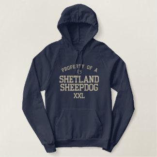 Propriété d'un chien de berger de Shetland Sweatshirt Avec Capuche Brodé