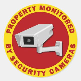 Propriété surveillée par des caméras de sécurité sticker rond