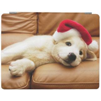 Protection iPad Le chiot porte un casquette de Noël et le mensonge