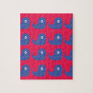 Puzzle Baleines de conception bleues sur le rouge