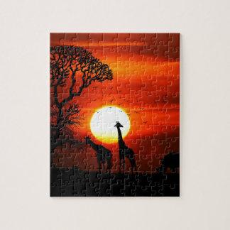 Puzzle Coucher du soleil orange en silhouette de girafe