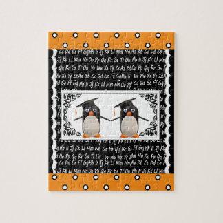 Puzzle Deux pingouins de graduation, ABC ont cranté