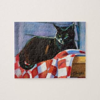 Puzzle Nappe rouge de contrôle de chat noir