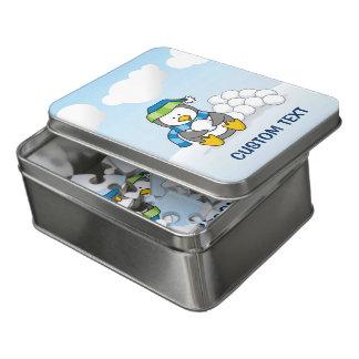 Puzzle Petit pingouin se reposant avec des boules de