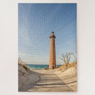 Puzzle Peu de phare de point de sable sur le lac Michigan