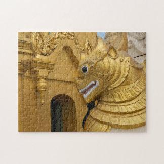Puzzle Statue d'or de lion au temple