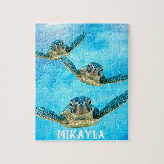 Puzzle Trois tortues de mer de bébé nageant