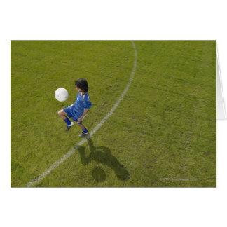 Qualifications de pratique de footballer du garçon carte de vœux