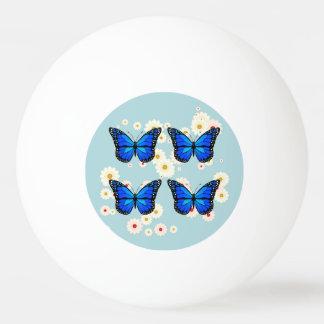 Quatre papillons bleus balle tennis de table