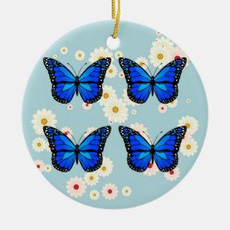 Quatre papillons bleus ornement rond en céramique