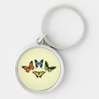 Quatre papillons - porte - clé porte-clé rond argenté