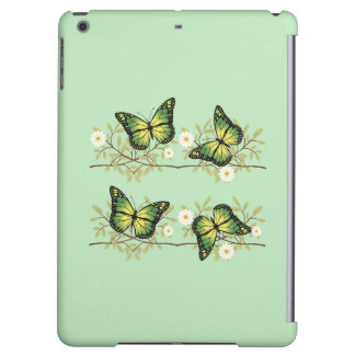 Quatre papillons verts
