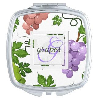 Raisins et vignes doux miroirs compacts