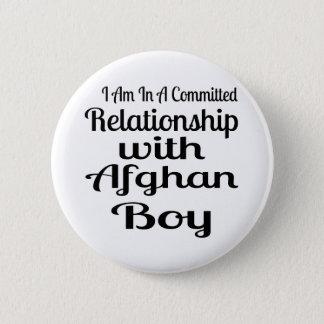 Rapport avec le garçon afghan badge