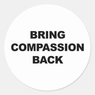 Rapportez la compassion sticker rond