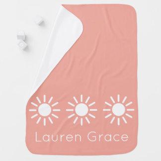 Rayons de soleil vintages de roses pâles et de couverture de bébé