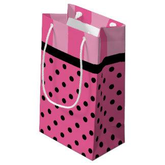 Rayures d'amour et sacs roses de cadeau de partie