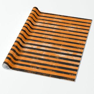 Rayures grunges noires oranges de texture de papier cadeau