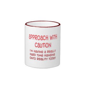 réalité mug ringer