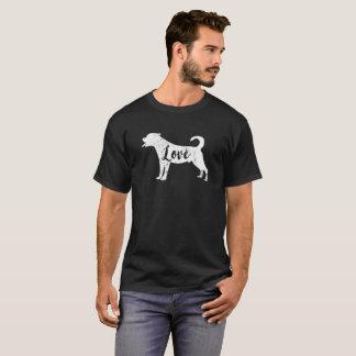 Regard vintage de T-shirt de rottweiler d'amour