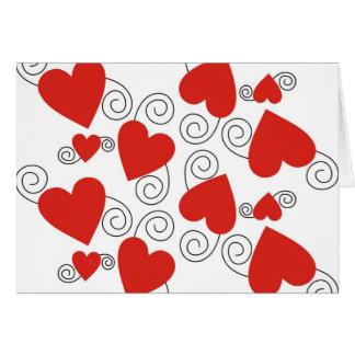 Remous de noir et carte rouge de coeur