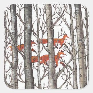 Renards rouges dans l'enveloppe de cadeau unique sticker carré