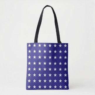 Répétition des étoiles de blanc sur le motif bleu tote bag
