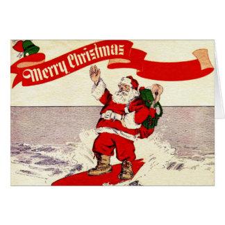 Rétro carte de voeux surfante de Père Noël