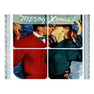 Rétro carte postale de baiser de couples de Noël