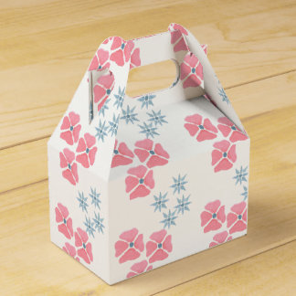Rose et cadeau/boîte floraux bleus de faveur ballotins