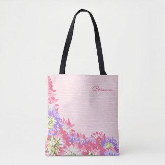 Rose féminin et le mauve fleurit le monogramme sac