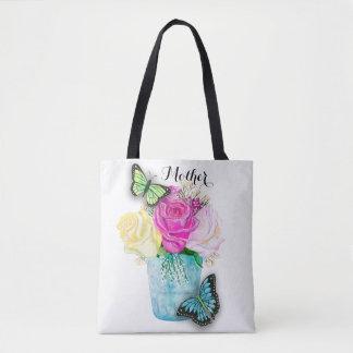 Roses de ressort du jour de mère dans le vase avec sac