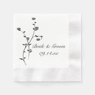 Roses noirs et blancs épousant les serviettes de serviette jetable