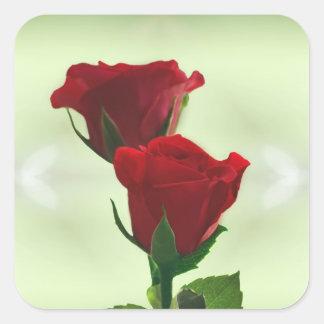 Roses rouges d'amour jumel de flamme sticker carré