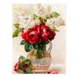 Roses rouges vintages et carte postale du souffle