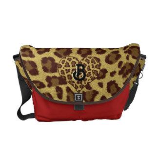 rouge initial de sac d'empreinte de léopard besace