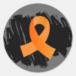 Ruban orange de sclérose en plaques avec le sticker rond