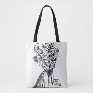 Sac fourre-tout noir et blanc à conception florale