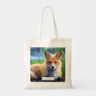 Sac Fox rouge s'étendant dans le pittoresque d'herbe