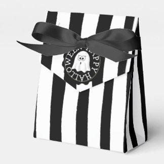 Sacs noirs et blancs heureux de cadeau de ballotins