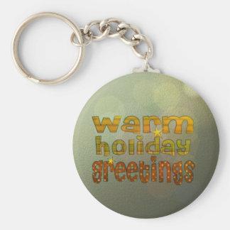 Salutations chaudes de vacances porte-clé