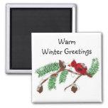 Salutations chaudes d'hiver aimant