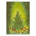 Salutations de Noël recueillant autour d'un tree_1 Carte