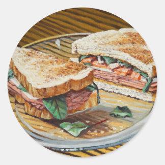 Sandwich à jambon, à salami et à fromage sticker rond