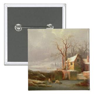 Scène de neige avec le moulin et les cottages badge