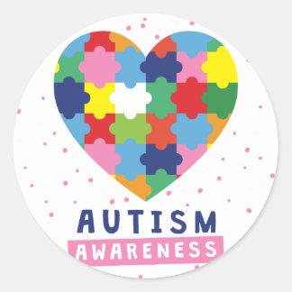 sensibilisation sur l'autisme rose sticker rond