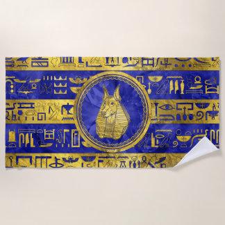 Serviette De Plage Anubis d'or avec des hiéroglyphes sur le bleu